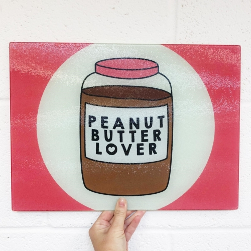 Peanut Butter Lover - glass chopping board by Stephanie Komen