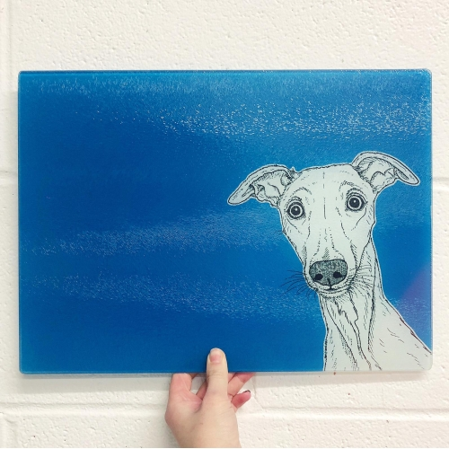 Whippet Dog Portrait ( blue background ) - glass chopping board by Adam Regester
