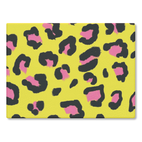 Leopard print yellow and pink - glass chopping board by Cheryl Boland