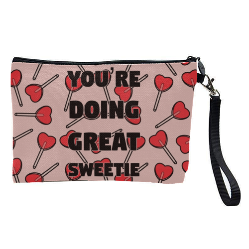 Sweetie print - pretty makeup bag by Kimberley Ambrose